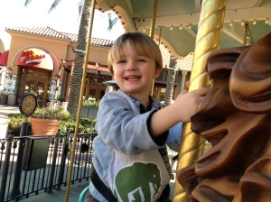 Riding the carousel during an outing with Aunt Jacki.
