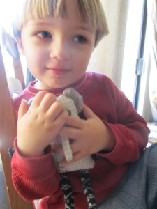 Eli hugging his elephant