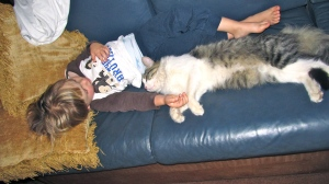 Eli sleeping with the cat